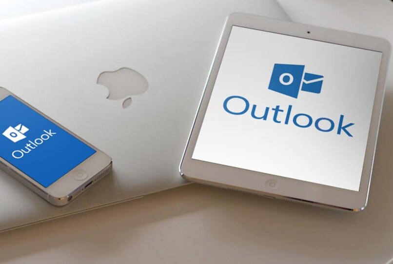apple devices with outlook logo on screen